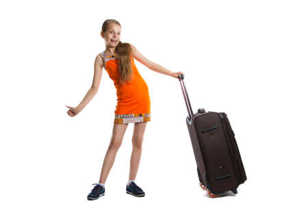 cute girl ready for summer vacation. Joyful girl with luggage bag about to travel. Isolation on a white background