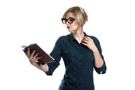 summarize: Young cute girl with glasses with a book in his hands. A girl wearing a plaid shirt. Isolation on a white background