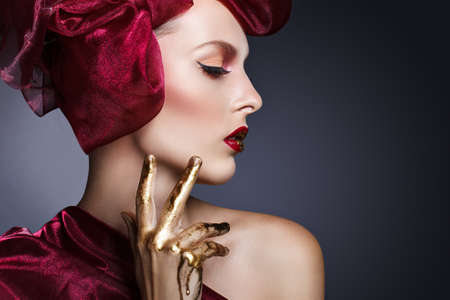 beauty fashion portrait of young attractive model with red and golden make-up