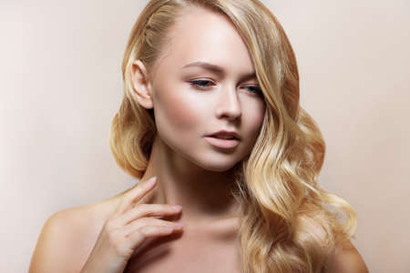 Beauty Woman Portrait. Beautiful Spa Girl Perfect Fresh Skin. Youth and Skin Care Concept. Beige background Stock Photo