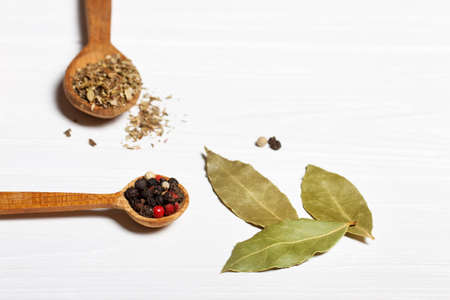 bay leaf and pepper mixture. Spices on a white wooden background. horizontal top and a blank space for text