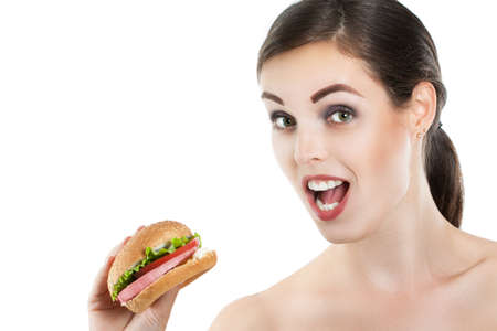 funny girl eating hamburger on white background