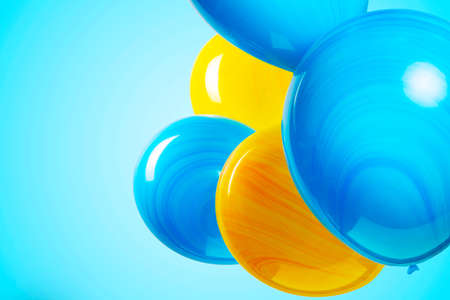 colorful balloons isolated on blue turquoise background. Birthday party, positive mood.