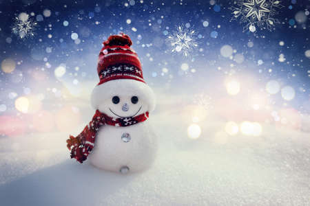 Merry snowman standing in a winter night Christmas landscape. Merry Christmas and Happy New Year Greeting Card Imagens
