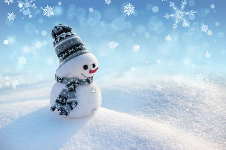Merry snowman standing in a winter Christmas landscape. Merry Christmas and Happy New Year greeting card