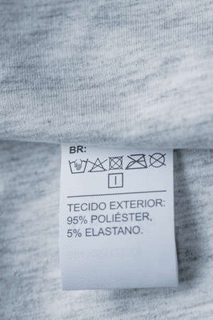 Clothing care label. Close-up tag on a knitwear Imagens