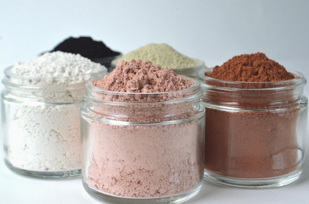 Cosmetic clays and powders for beauty face masks and skin detox - French green clay, red clay, kaolin, pink clay and powdered activated charcoal