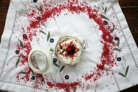 muesli with raspberries yogurt honey and berries on a white tablecloth background for the inscription