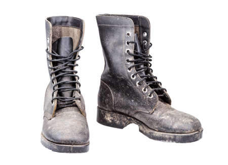 dirty combat boots isolated on white photo