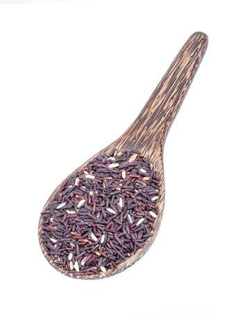 Organic Riceberry Rice (black jasmine rice) on wooden ladle isolated on white photo
