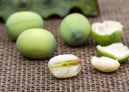 seedpod: Fresh green lotus seed (lotus nut) on black plate