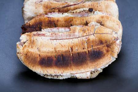 to flatten: Flatten roasted or grilled banana on black plate