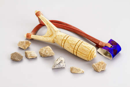 Wooden catapult slingshot with stone bullets ready to use