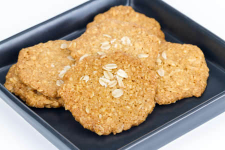 Homemade Oat biscuit cookies on black dish
