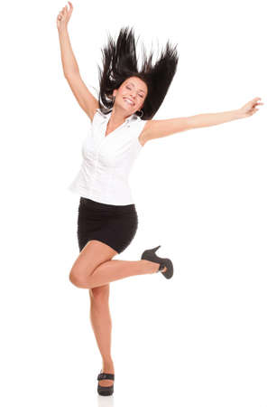 crazy woman: A joyous young female business executive celebrating success with raised hands on white