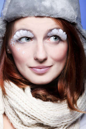 Beautiful young woman portrait with white eye-lashes eyelash hat photo