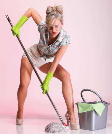 Cheerful pin up girl retro style portrait pinup Woman housewife cleaner mop pink background full lenght photo