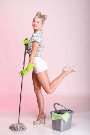full lenght: Cheerful pin up girl retro style portrait pinup Woman housewife cleaner mop pink background full lenght