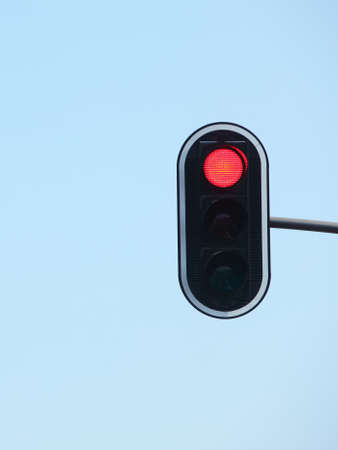 Red traffic lights against blue sky backgrounds photo