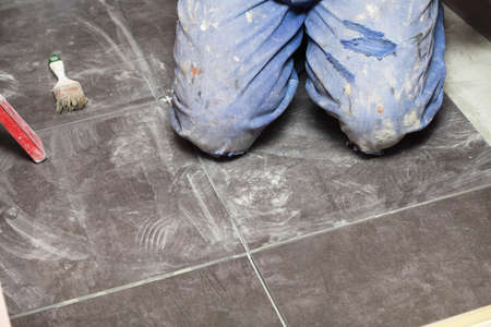 Man Construction worker is tiling at home, tile floor adhesive Stock Photo - 15773847