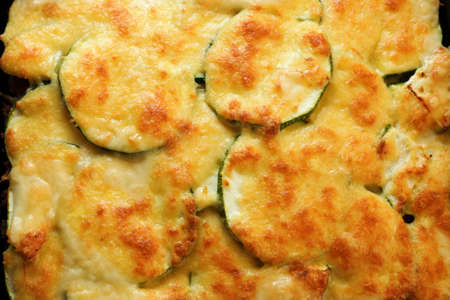 browned: shallow focus of dauphinoise courgette potatoes or potato au gratin