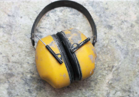 Ear protection muff Yellow noise muffs toolwork photo
