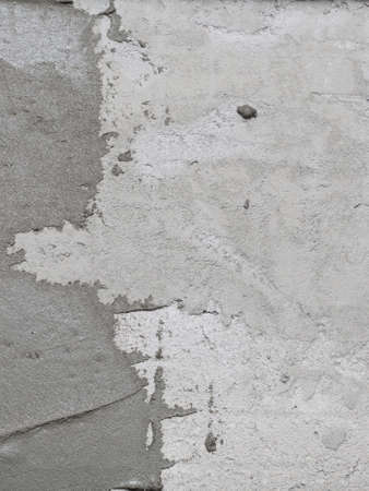 concrete surface finishing: Construction worker is tiling at home, tile floor adhesive Abstract plaster stucco wall