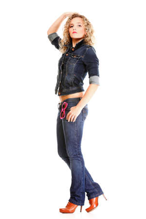Beautiful young woman blonde 20s standing full body in jeans wear isolated on white background Caucasian girl Stock Photo - 15981214