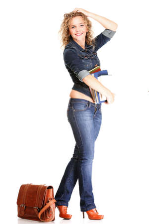 Beautiful young woman blonde 20s standing full body in jeans shoulder bag isolated on white background Caucasian girl Stock Photo - 16336561