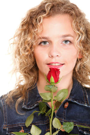 portrait of attractive caucasian smiling woman blond isolated on white studio shot in red rose photo