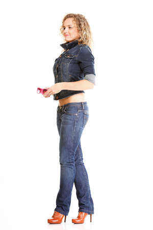 Beautiful young woman blonde 20s standing full body in jeans wear isolated on white background Caucasian girl Stock Photo - 16671087