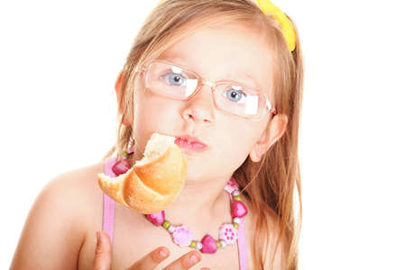 sweet little baby girl eating bread isolated on white Stock Photo - 16729152