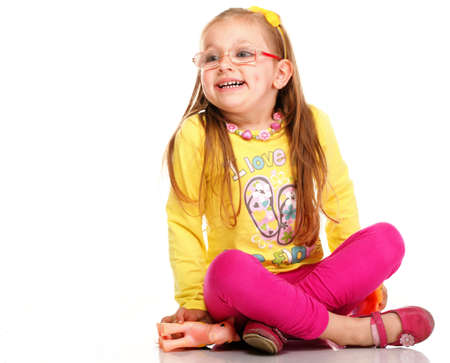 cheerful little girl glasses funny toy horse isolated on the white background Stock Photo - 16757690