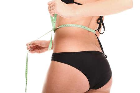 cintura perfecta: Chica de medición mujer, la forma perfecta de muslo hermoso. Estudio aislado