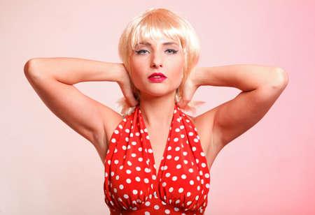 young beautiful blond caucasian woman posing retro styling photo