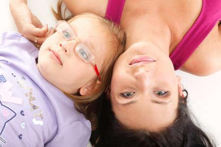 happy family, litle baby girl lying mom photo