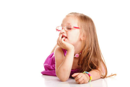 cheerful little girl glasses funny is lying isolated on the white background Stock Photo - 16907598