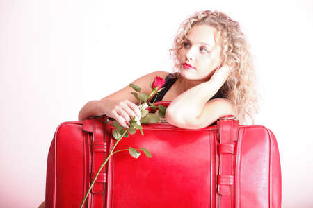 portrait of attractive caucasian woman blond wait red rose photo