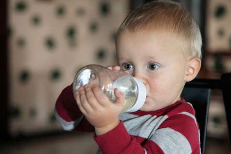 baby boy having his bottle Stock Photo - 17413724