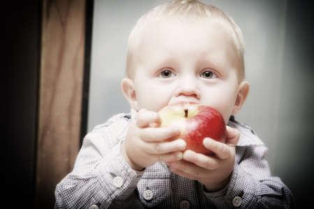 Little boy eating apple Stock Photo - 17413699