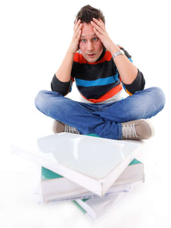 tired college student with stack of books isolated photo