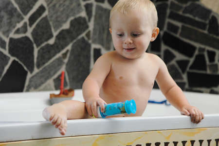 little baby boy taking a bath playing Stock Photo - 17481375
