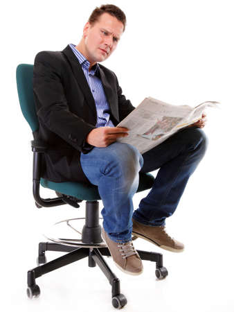 Businessman reading a newspaper isolated Stock Photo - 17481390