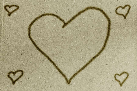 Hearts on vintage green paper texture background photo