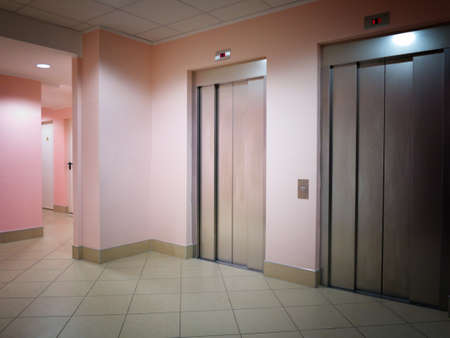 Two closed modern elevators in a business lobby photo