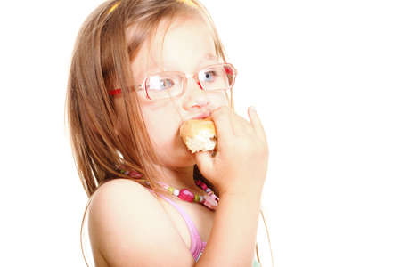 sweet little baby girl eating bread isolated on white Stock Photo - 17726077