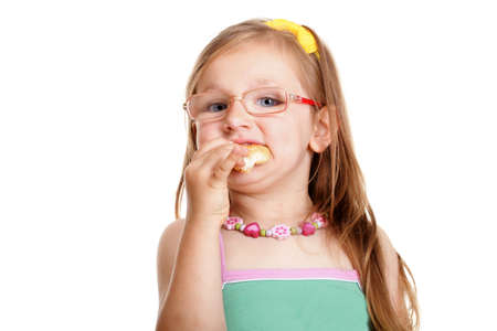 Pretty little girl in glasses eating a bread doing fun isolated on white background Stock Photo - 17726039