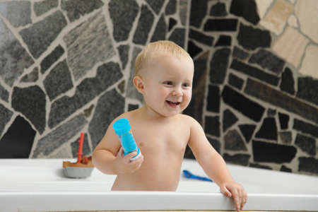 little two years old baby boy taking a bath playing with soap bubbles Stock Photo - 17786968