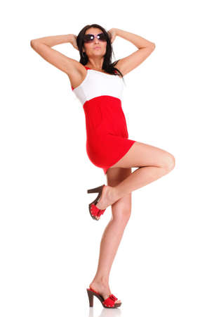 Happy surprised latin woman in red dress Isolated on white photo