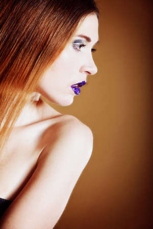 portrait of young beautiful woman long hair colorful make up brown background Stock Photo - 17786916